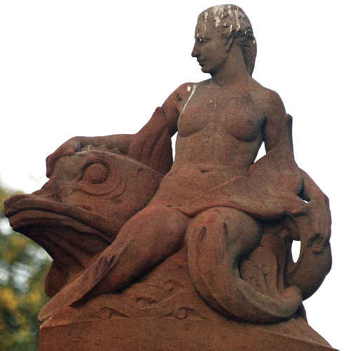 The Mermaid and The Fish at the entrance to the Fitzroy Gardens compliments of www.flickr.com/photos/d-l-j-h/483917140/