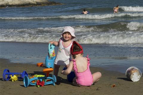 Children having fun at the beach