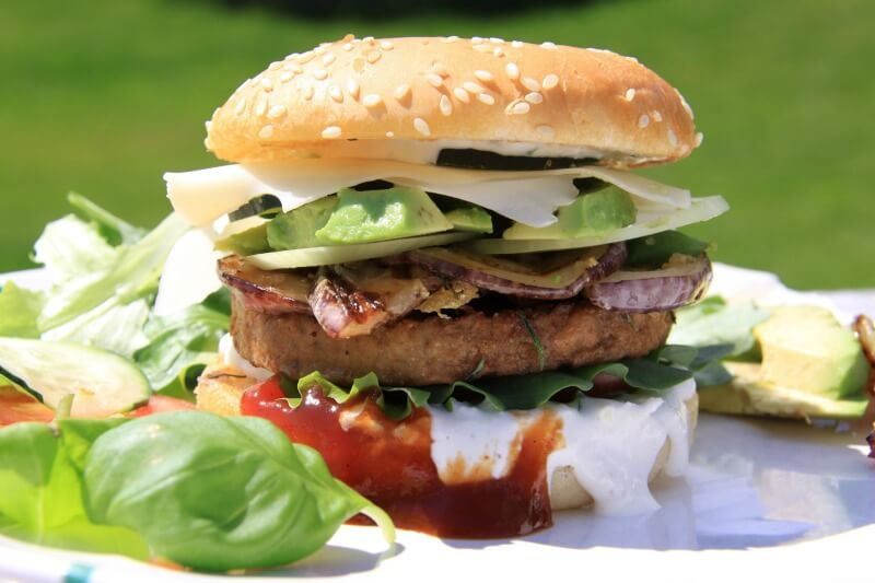 Delicious bread roll with bbq hamburger and salad