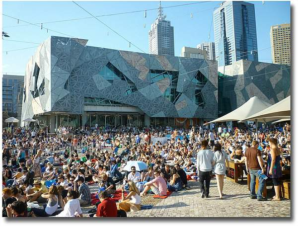 Watching tennis on the Big Screen at Federation Square in Melbourne Australia compliments of http://www.flickr.com/photos/raguy/4449801514/