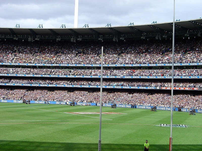 Australian Rules Football played at the MCG compliments of By AsianFC. (http://flickr.com/photos/9753072@N03/1460062833) [CC BY 2.0 (http://creativecommons.org/licenses/by/2.0)], via Wikimedia Commons