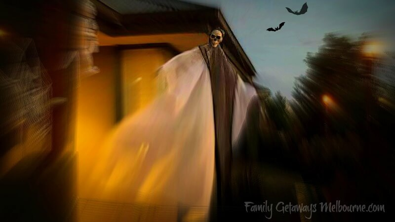 ghostly Halloween skeleton flying in the breeze