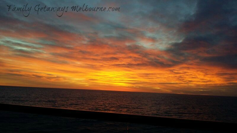 Sunrise from the balcony of cabin on the Golden Princess cruise ship
