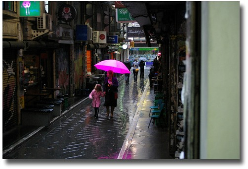 Walking the Melbourne arcades with a pink brolly in the rain compliments of http://www.flickr.com/photos/35314767@N00/2749370752/