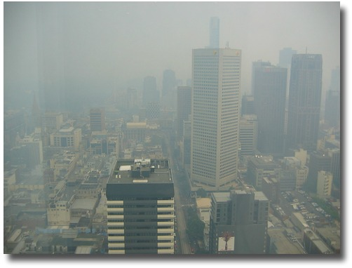 Smoke engulfs the city of Melbourne -  Australia compliments of http://www.flickr.com/photos/cicada/327833593/