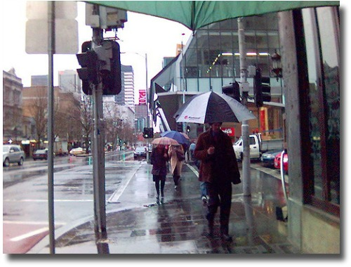 Wet, windy and cold Melbourne, Australia street compliments of http://www.flickr.com/photos/avlxyz/836961481/