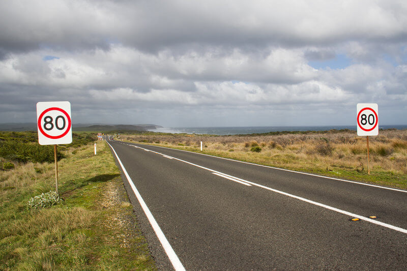 80 speed limit sign on the Great Ocean Road i Victoria, Australia compliments of https://flic.kr/p/fShGQP