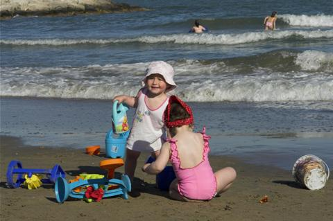 Children having fun at the beach