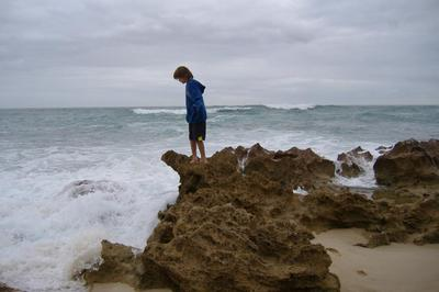 My cousin watching his dam collapse as the waves encroach at Wreckage Bay