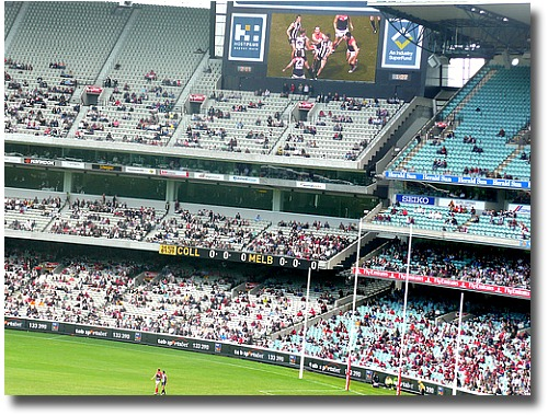 Aussie rules football clash between Collingwood and Melbourne at the MCG compliments of http://www.flickr.com/photos/gorey/3412945484/