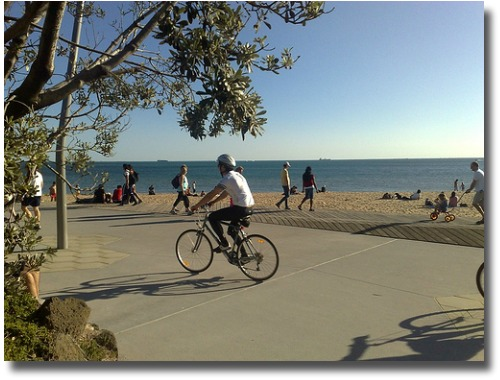 Riding a bike along the St Kilda Esplanade compliments http://www.flickr.com/photos/pcalcado/2854534805/