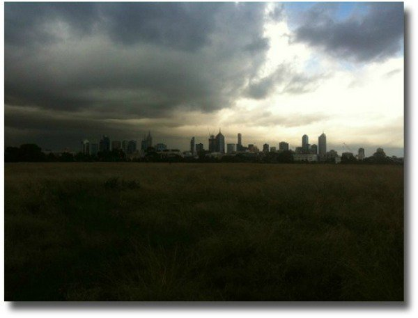 Storm clouds over the Melbourne skyline compliments of http://www.flickr.com/photos/cafuego/5709270153/